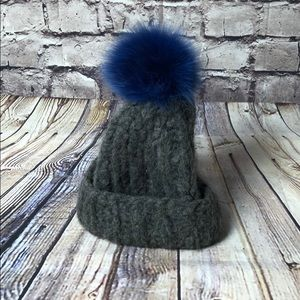 Hat with blue pompon